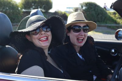 Kate and Sarah smiling in car